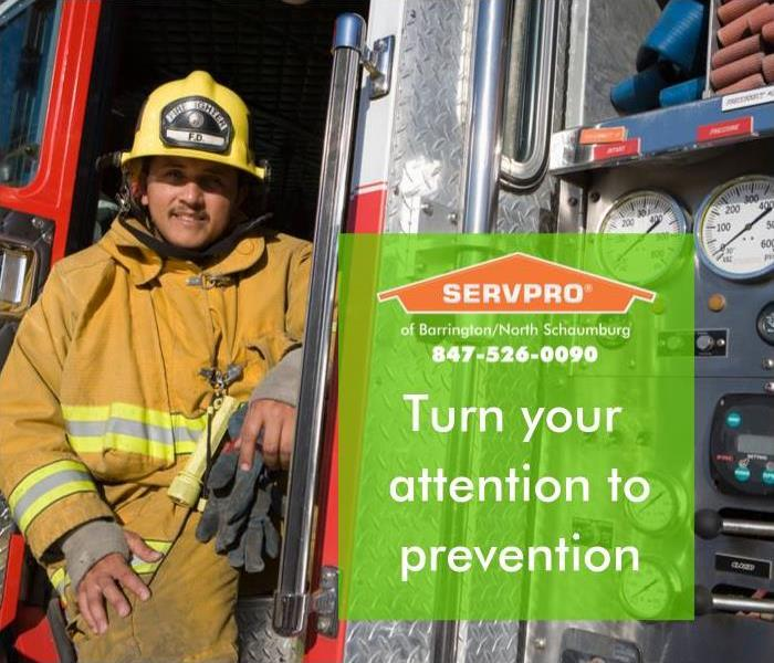 "Fireman standing by fire truck with image saying ""Turn your Attention to fire prevention written on sidebar."